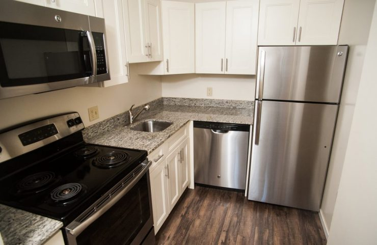 kitchen with granite countertop and stainless steel appliances