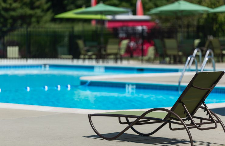 umbrella tables and poolside lounge chairs