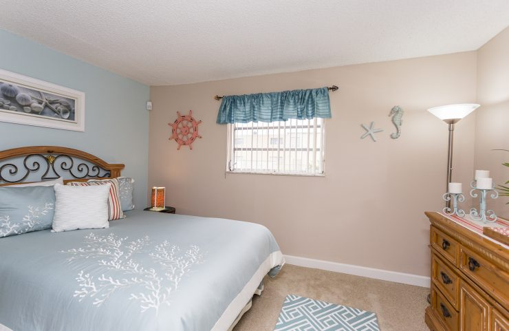 bedroom with carpet and window
