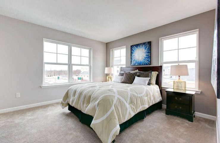 beige carpeted bedrooms