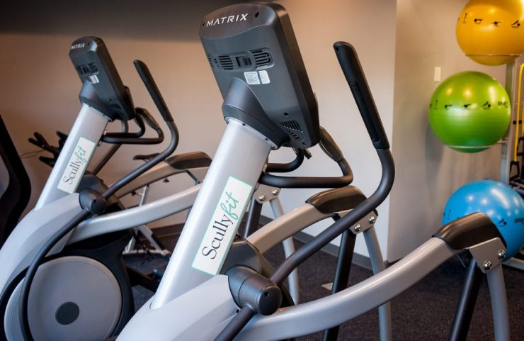 virtual active ellipticals and treadmills in fitness center