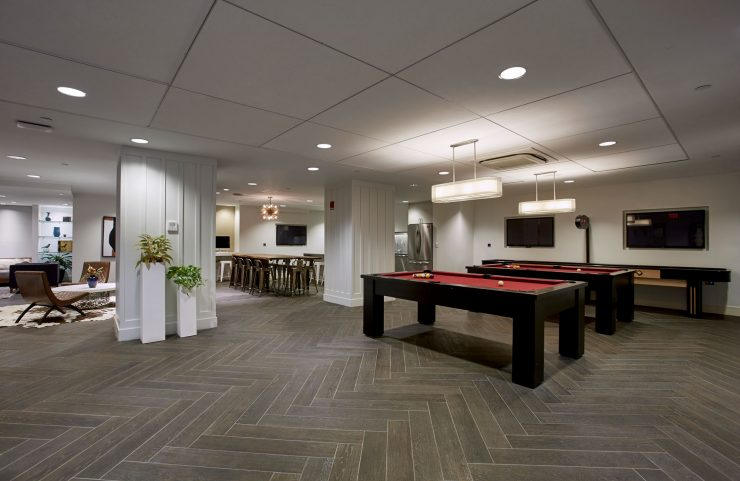 two pool tables and shuffleboard in club level lounge