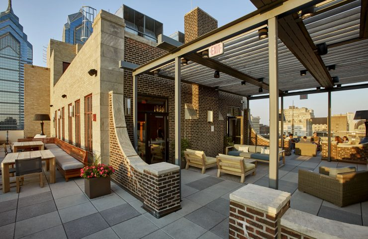 sky deck with cozy outdoor seating and fireplace
