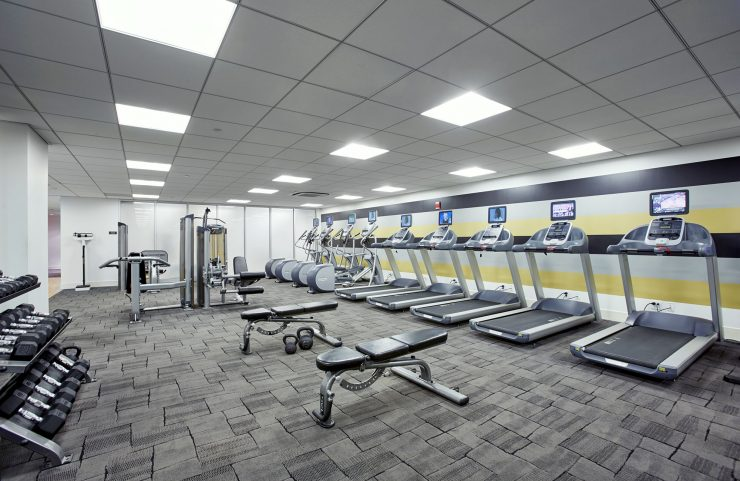 large fitness center with treadmills and elliptical machines