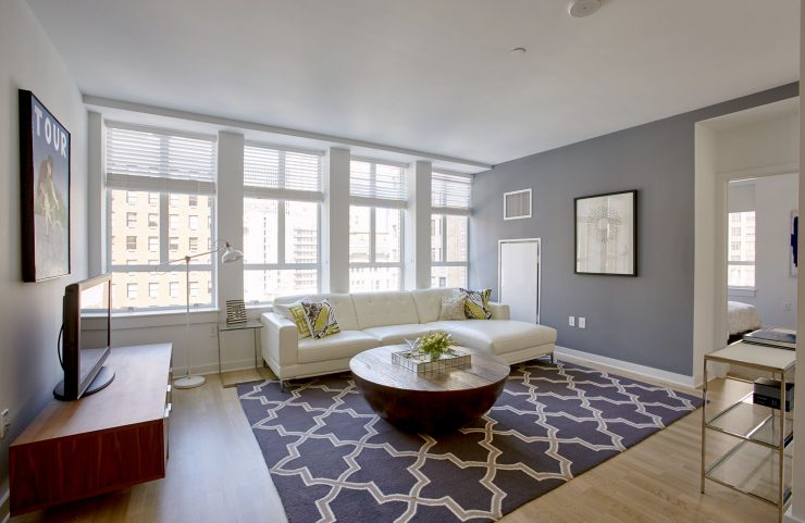 large living room featuring large windows to see the views of Philadelphia
