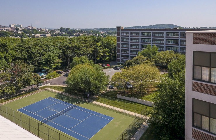 Aerial view of bridgeview apartments and tennis courts