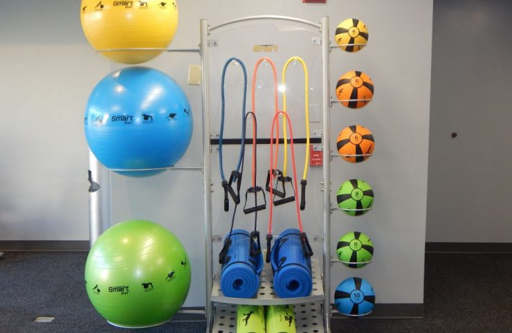gym equipment including bands, yoga mats and weight balls
