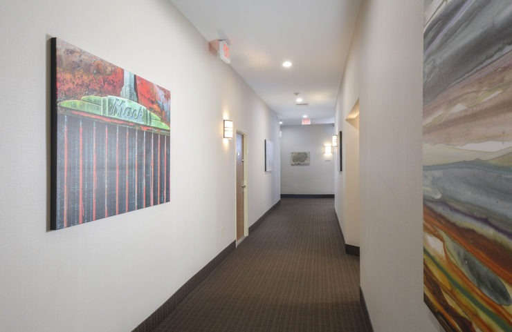 bright hallways with large colorful paintings