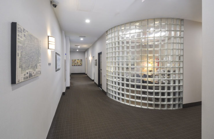 main lobby and leasing office behind glass block wall