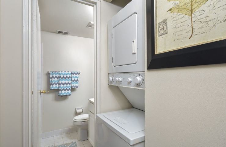 stackable washer and dryer outside bathroom