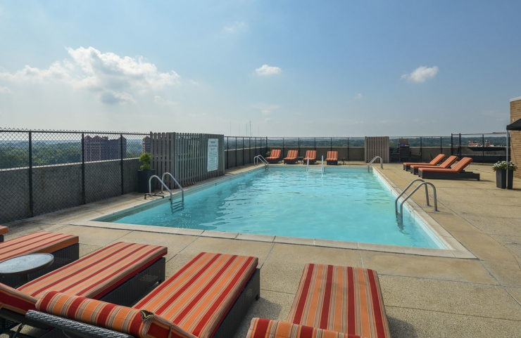 rooftop pool with padded lounge chairs