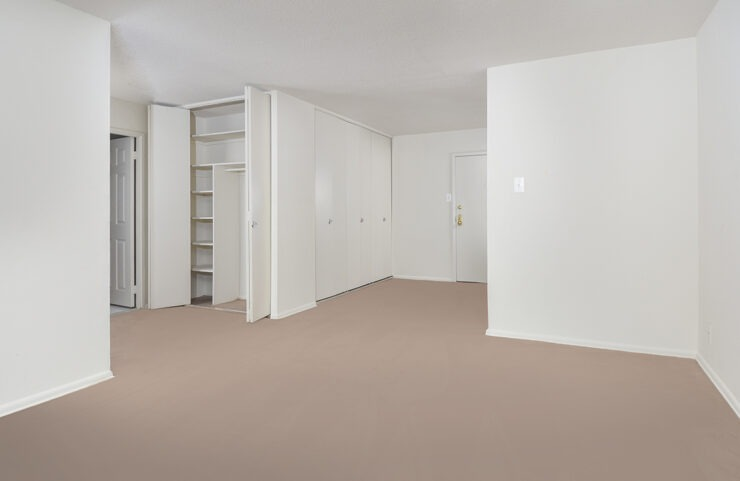 front door to apartment with ample closet space