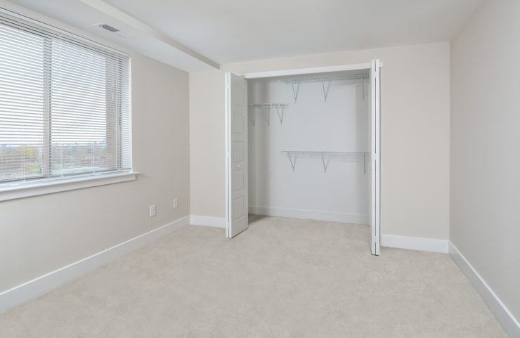 Penthouse bedroom with wall to wall carpeting and large closets