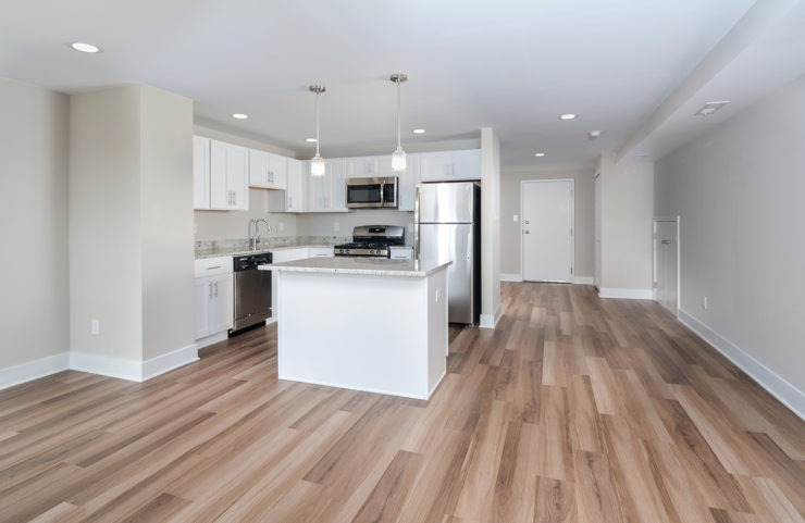 Penthouse open concept kitchen and living room with wood floors