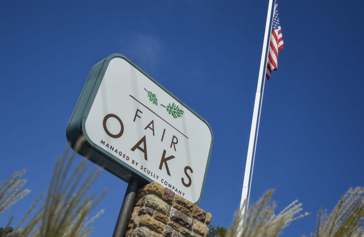 tall fair oaks sign with flag pole behind