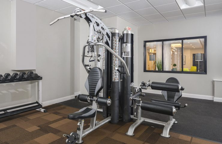 weight machine and free weights in fitness center
