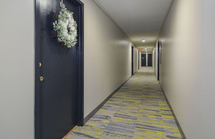 large bright hallway with entrances to apartments