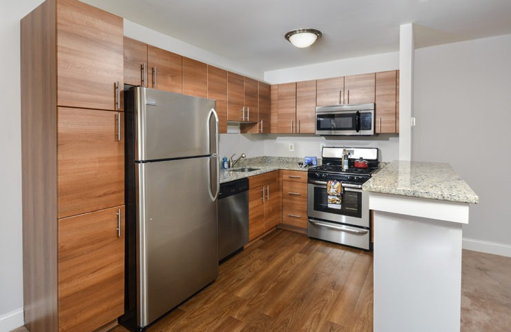 Updated kitchen with granite countertop and stainless steel appliancs