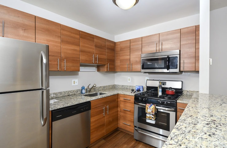 updated kitchen with plank flooring