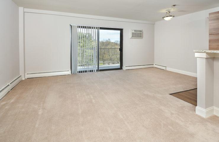 open living room with sliding doors to balcony