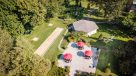 aerial view of umbrella tables, horseshoes, bocce ball