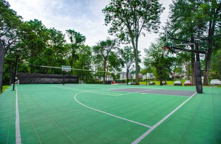 sports court with mature trees surrounding