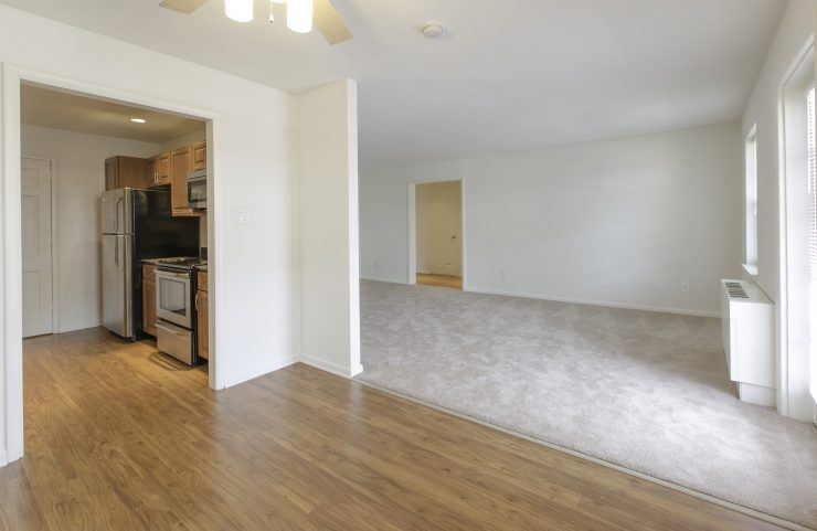 kitchen and dining room with laminate wood floors and carpeted living room