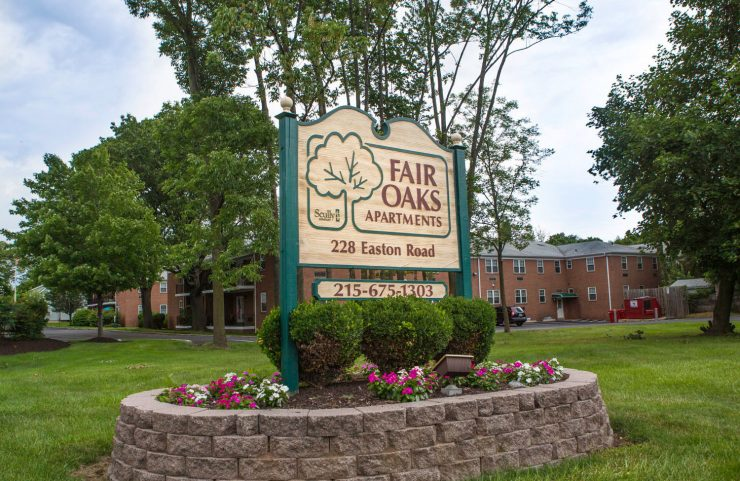 closeup of fair oaks sign with flowers around