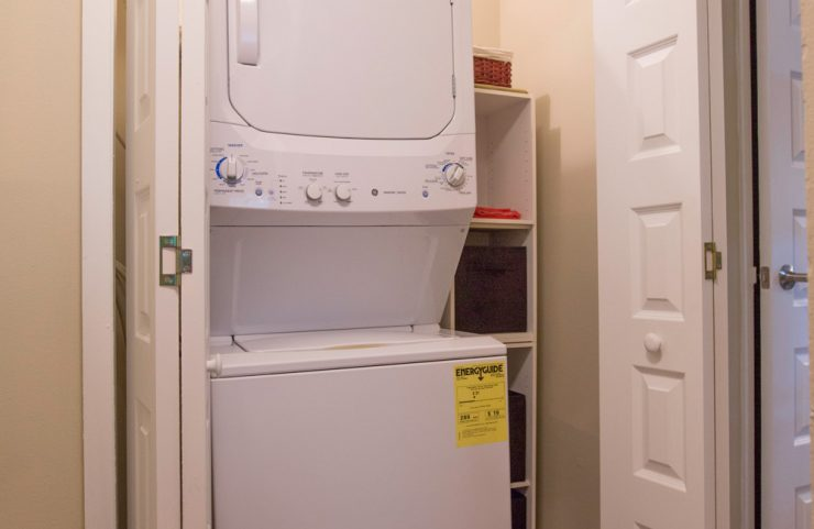 stackable washer and dryer in a roomy closet