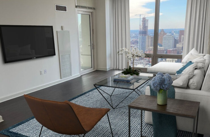 living room with large floor to ceiling windows to capture the view of philly
