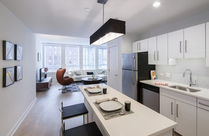 Kitchen features include sleek high gloss white cabinets with soft close drawers and doors