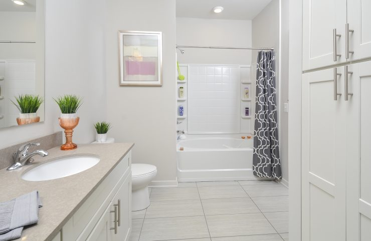 bathroom with tile floor and large vanity
