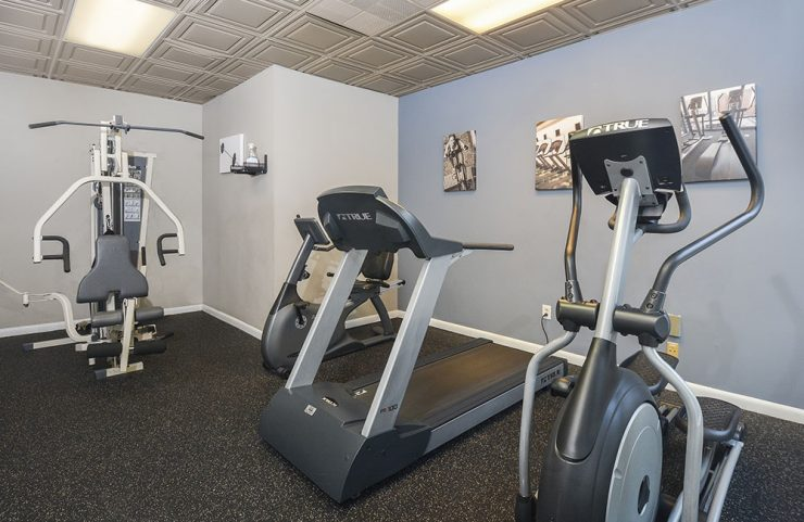 elliptical, treadmill and weight machine in fitness center