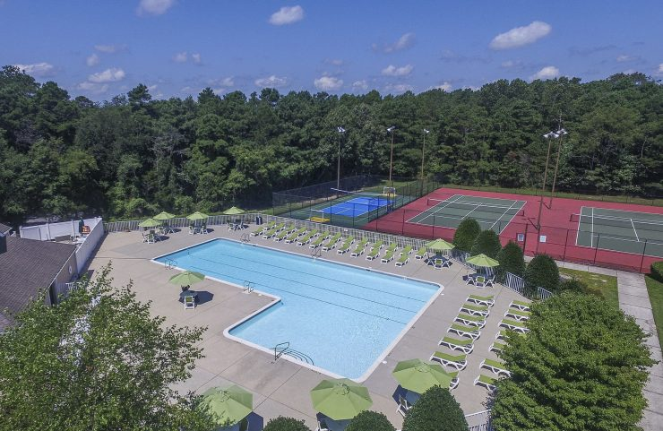 aerial view of the pool and tennis courts