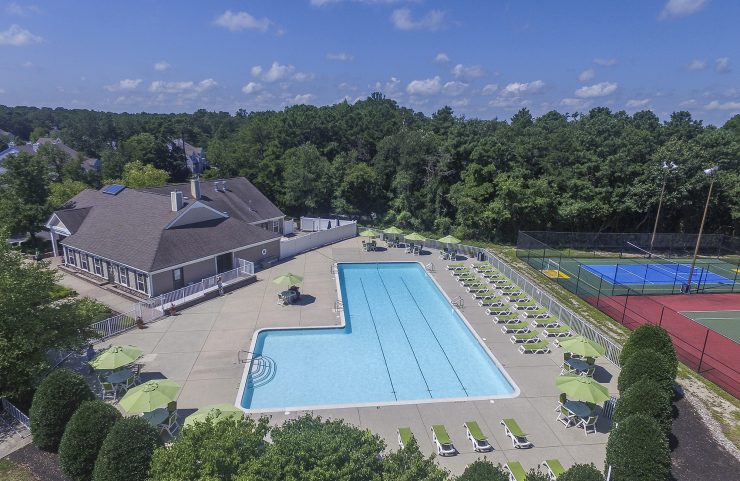 aerial view of the pool and clubhouse