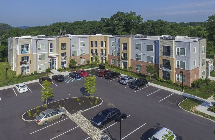 aerial view of apartments and parking lot