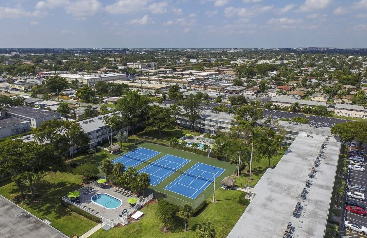 aerial view of set point, 3 tennis courts and the pool