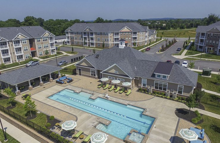 aerial view of the outdoor pool and clubhouse