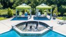 cabana area with fountain feature in pool