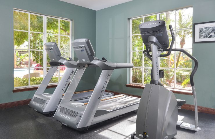 two treadmills and an elliptical in the fitness center