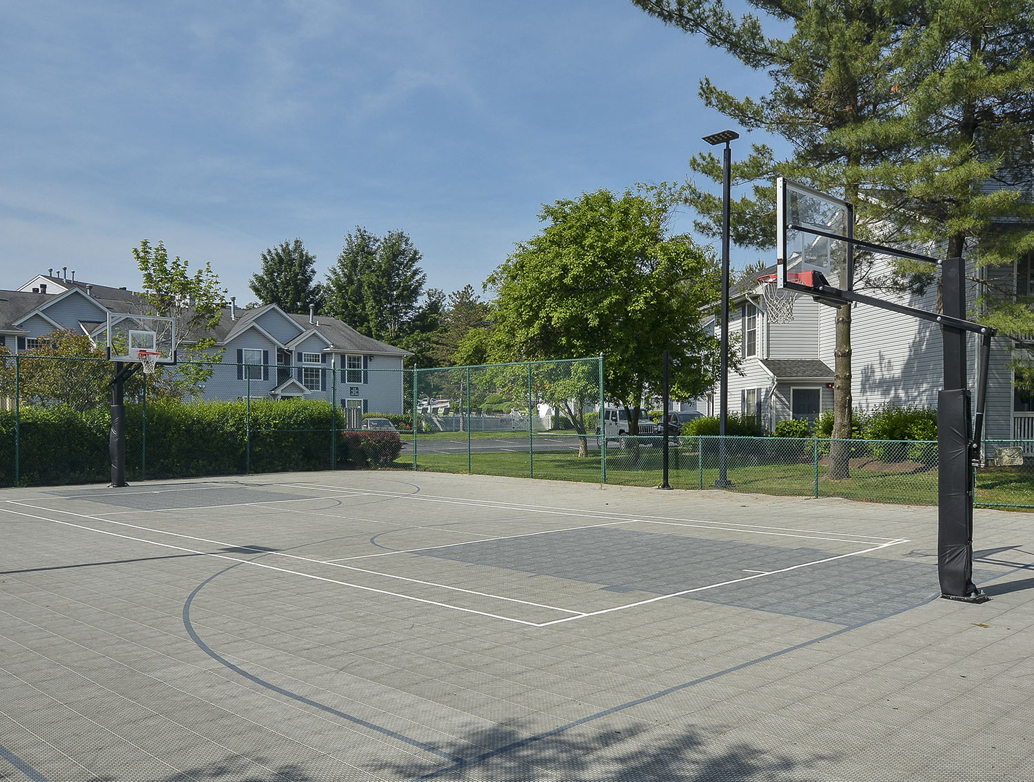multi-sport court with basketball hoops, badminton, volleyball and tennis