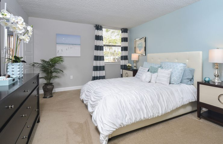 large bedroom with wall to wall carpet