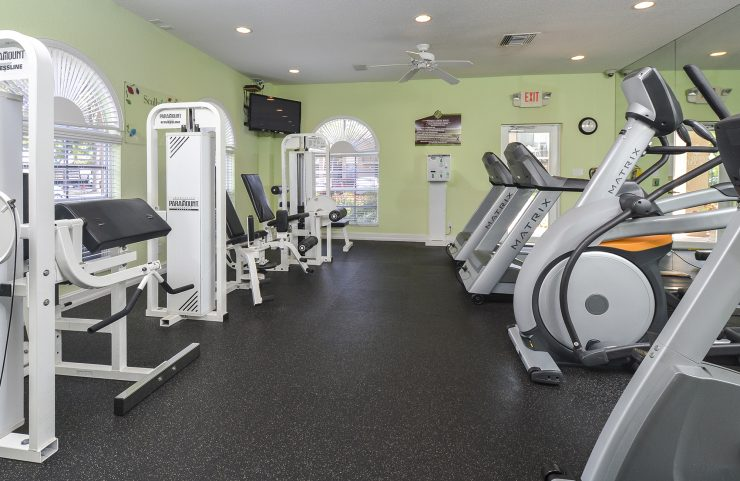 strength training and cardio machines in fitness center