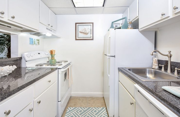 standard kitche with white appliances and white cabinets