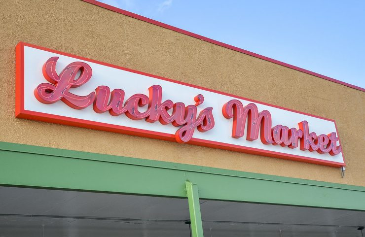 nearby: lucky's market signage