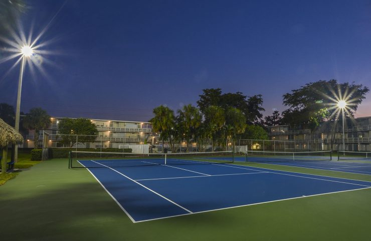 tennis courts lit up at night