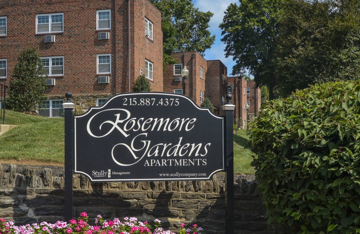 rosemore garden sign infront of stone wall