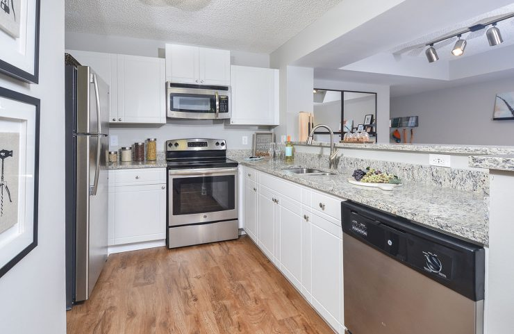 kitchen with white shaker cabinets and breakfast bar