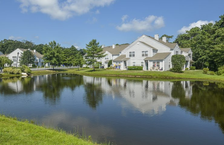 apartments surrounding beautiful pond