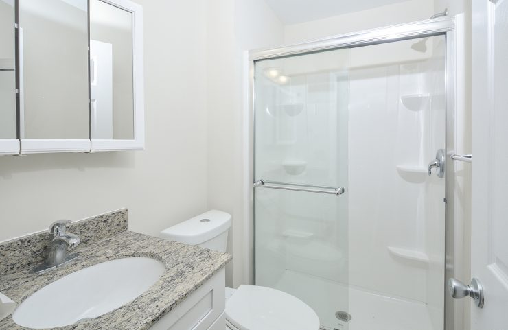 bathroom with white vanity and mirror